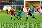 Kerry U17's Daniel Okwutev pushes upfield but is tackled by Carlow/Kilkenny's Dylan Stickel in the League of Ireland in Mounthawk Park on Sunday.