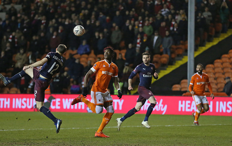Arsenal's Stephan Lichtsteiner just manages to direct the ball away from Blackpool's Armand Gnanduillet<br /> <br /> Photographer Stephen White/CameraSport<br /> <br /> Emirates FA Cup Third Round - Blackpool v Arsenal - Saturday 5th January 2019 - Bloomfield Road - Blackpool<br />  <br /> World Copyright &copy; 2019 CameraSport. All rights reserved. 43 Linden Ave. Countesthorpe. Leicester. England. LE8 5PG - Tel: +44 (0) 116 277 4147 - admin@camerasport.com - www.camerasport.com