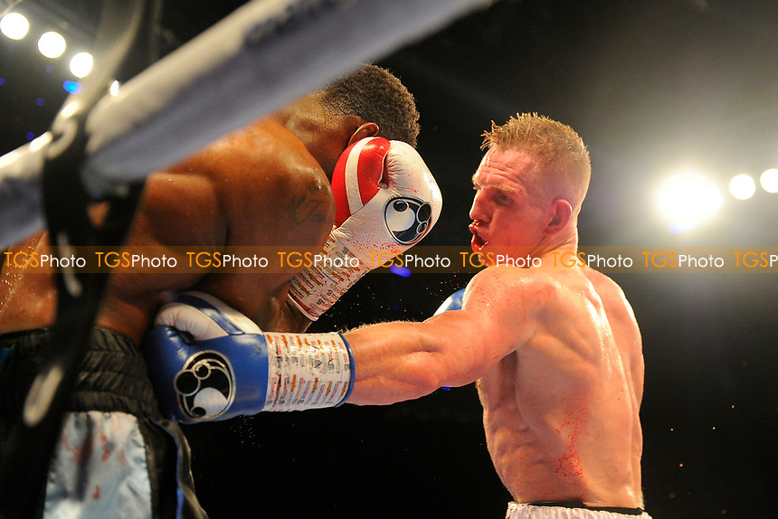 Ted Cheeseman (white shorts) defeats Asinia Byfield during a Boxing Show at the Copper Box Arena on 27th October 2018
