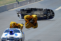 Jul, 22, 2012; Morrison, CO, USA: NHRA pro stock driver Paul Pittman (back) crashes behind Allen Johnson during the Mile High Nationals at Bandimere Speedway. Pittman would be uninjured in the incident. Mandatory Credit: Mark J. Rebilas-