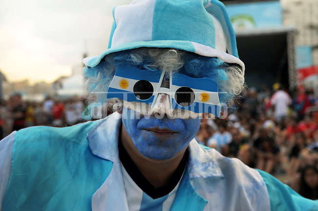 An Argentina supporter reacts during a live broadcast of the soccer World Cup match between Gana and Germany on Copacabana beach, Rio de Janeiro, Brazil, June 21, 2014