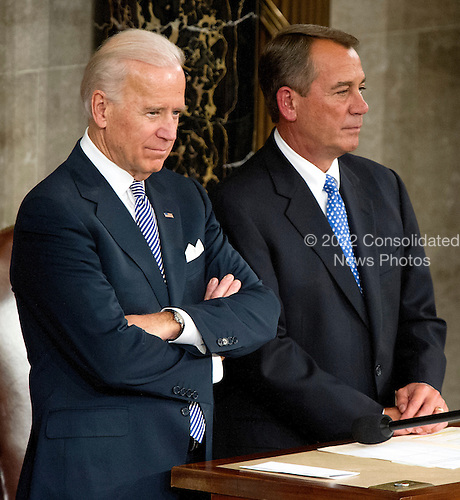 United States Vice President Joesph Biden, left, and Speaker of the U.S. House John Boehner (Republican of Ohio), right await the arrival of U.S. President Barack Obama to deliver the State of the Union Address to a Joint Session of Congress in the U.S. Capitol in Washington, D.C., Tuesday, January 24, 2012..Credit: Ron Sachs / CNP