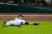 Houston Astros outfielder Jason Michaels #4 lays on the ground after making a diving catch during the Major League Baseball game against the Philadelphia Phillies at Minute Maid Park in Houston, Texas on September 13, 2011. Michaels suffered a season ending injury. Houston defeated Philadelphia 5-2.  (Andrew Woolley/Four Seam Images)
