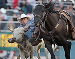 K.C. Jones competes in the steer wrestling event at the Reno Rodeo, in Reno, Nev. on Friday night, June 22, 2012..Photo by Cathleen Allison