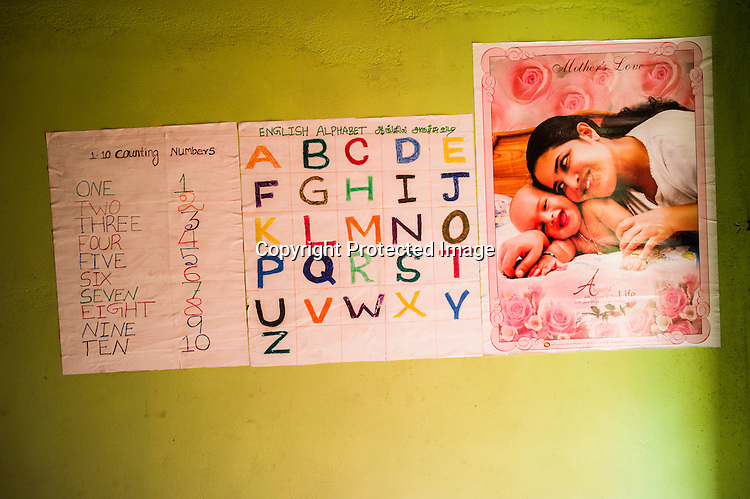 A wall in the room of a young expecting woman in Punaineeravi village in Kilinochchi in Northern Sri Lanka. Photo: Sanjit Das/Panos