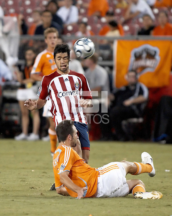 Houston Dynamo defender Ryan Cochrane (9) deflects the ball off the face of CD Chivas USA midfielder Paulo Nagamura (26).  Houston Dynamo defeated CD Chivas USA 4-0 at Robertson Stadium in Houston, TX on June 21, 2007.