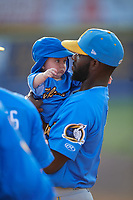 Myrtle Beach Pelicans Delvin Zinn (1) with Ethan Roberts (not shown) baby before a Carolina League game against the Potomac Nationals on August 14, 2019 at Northwest Federal Field at Pfitzner Stadium in Woodbridge, Virginia.  Potomac defeated Myrtle Beach 7-0.  (Mike Janes/Four Seam Images)
