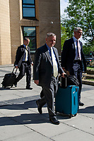 Pictured: Chris Davies, MP (C) leaves Cardiff Magistrates Court.<br /> Re: A judge has ruled that Conservative MP Chris Davies did not deliberately mislead an employment tribunal when he said that he would not face criminal charges over expenses claims.<br /> But the Brecon and Radnorshire MP later pleaded guilty to claiming £700 with false invoices for office photographs.<br /> He is being sued for constructive dismissal by his former constituency office manager, Sarah Lewis.<br /> The judge in Cardiff said the case will go to a full hearing at a later date.