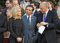 Counselor to the President Kellyanne Conway, left, George Sifakis, Director of the Office of Public Liaison, center, and Director of the National Economic Council and chief economic advisor Gary Cohn, right, speak prior to the arrival of United States President Donald J. Trump and first lady Melania Trump who will lead a moment of silence in remembrance of those lost on September 11, 2001 on the South Lawn of the White House in Washington, DC on Monday, September 11, 2017.<br /> CAP/MPI/CNP/RS<br /> &copy;RS/CNP/MPI/Capital Pictures