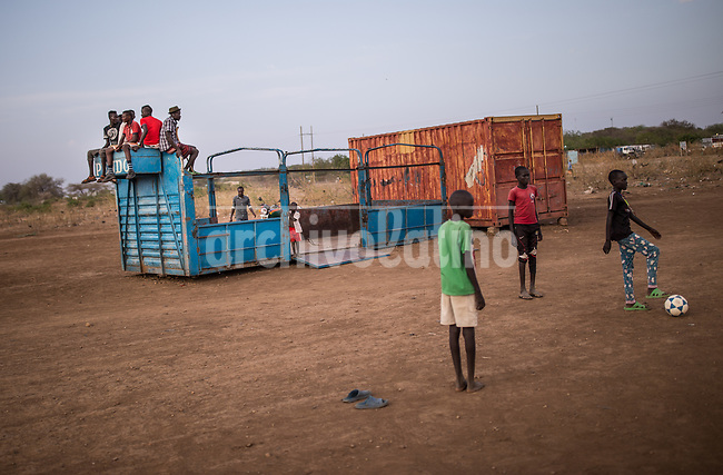 Children play soccer at Kakuma refugee camp in North of Kenya. Kakuma is the site of a UNHCR refugee camp, established in 1991. The population of Kakuma town was 60,000 in 2014, having grown from around 8,000 in 1990. In 1991, the camp was established to host the 12,000 unaccompanied minors who had fled the war in Sudan and came walking from camps in Ethiopia.