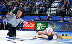 BROOKINGS, SD - JANUARY 18: Connor Brown from South Dakota State University gets takedown points on Drake Foster from Wyoming during their 125 pound match Thursday night at Frost Arena in Brookings. (Photo by Dave Eggen/Inertia)