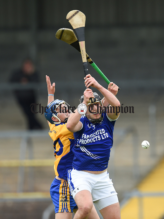 Michael Hawes of Cratloe in action against Brian Corry of Sixmilebridge during their game in Cusack Park. Photograph by John Kelly.
