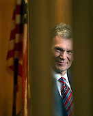Washington, D.C. - January 8, 2009 -- Former United States Senator Tom Daschle (Democrat of South Dakota) peers through a crack in the door as he waits to testify before the United States Senate Committee on Health, Labor, Education, and Pensions on his nomination to be Secretary of Health and Human Services in Washington, D.C. on Thursday, January 8, 2009..Credit: Ron Sachs / CNP