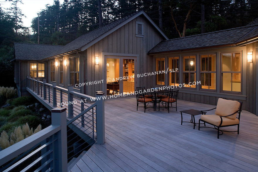 As night falls, a warm glow emanates from this Pacific Northwest home.