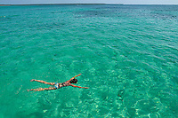Woman snorkeling by turquoise sea, Saona Island, Dominican Republic