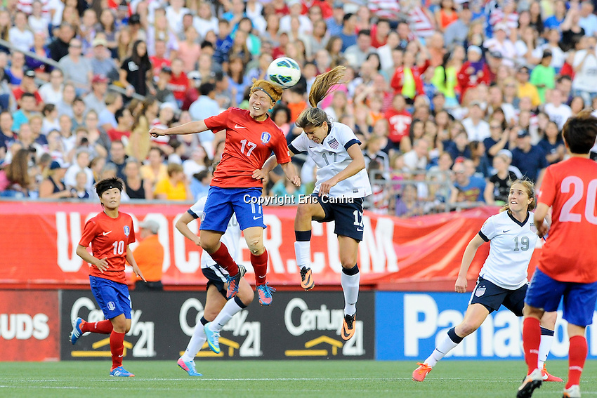 US Womens National midfielder Tobin Heath (17) and Korea Republic midfielder Park Heeyoung (17) in action during the International Friendly soccer match between the USA Women's National team and the Korea Republic Women's Team held at Gillette Stadium in Foxborough Massachusetts.   Eric Canha/CSM