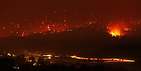 6/7/11- WALLOW FIRE-- Fire lights up a hillside south of State Route 260 Tuesday evening and building lights shine in the foreground. (Pat Shannahan/ The Arizona Republic)