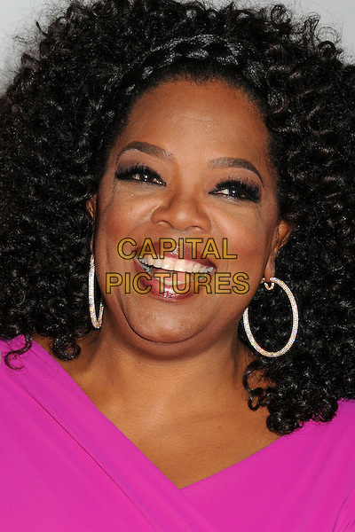 Oprah Winfrey<br /> &quot;Lee Daniels' The Butler&quot; Los Angeles Premiere held at Regal Cinemas L.A. Live, Los Angeles, California, USA.<br /> August 12th, 2013<br /> headshot portrait pink hoop earrings smiling mouth open<br /> CAP/ADM/BP<br /> &copy;Byron Purvis/AdMedia/Capital Pictures
