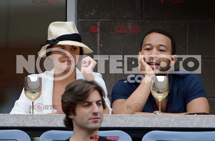 FLUSHING NY- SEPTEMBER 2: Sports Illastrated model Chrissy Teigen and fiance John Legend during Novak Jokovic Vs Julien Benneteau on Arthur Ashe stadium at the USTA Billie Jean King National Tennis Center on September 2, 2012 in in Flushing Queens. Credit: mpi04/MediaPunch Inc. ***NO NY NEWSPAPERS*** /NortePhoto.com<br />