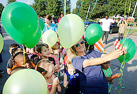 NWA Democrat-Gazette/DAVID GOTTSCHALK  Jill Jackson, kindergarten teacher at Asbell Elementary School in Fayetteville, poses with her class before a balloon release Friday, August 7, 2015. Three classes of kindergarten students participated in the annual release signifying the launch of their academic careers.