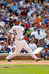 1 July 2005: Derrek Lee (right), first baseman for the Chicago Cubs, hits a triple in a game against the Washington Nationals. The visiting Nationals defeated the Cubs 4-3 at Wrigley Field in Chicago.  Mandatory Photo Credit: Ed Wolfstein