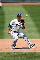 Binghamton Mets shortstop T.J. Rivera (5) waits for a throw on a stolen base attempt during a game against the Erie Seawolves on July 13, 2014 at Jerry Uht Park in Erie, Pennsylvania.  Binghamton defeated Erie 5-4.  (Mike Janes/Four Seam Images)