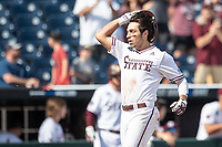 Mississippi State Bulldogs third baseman Marshall Gilbert (34) crosses the plate after hitting a home run during the seventh inning of Game 8 of the NCAA College World Series against the Vanderbilt Commodores on June 19, 2019 at TD Ameritrade Park in Omaha, Nebraska. Vanderbilt defeated Mississippi State 6-3. (Andrew Woolley/Four Seam Images)