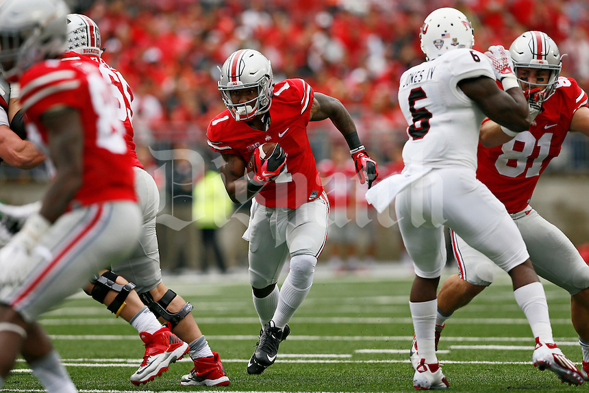 Ohio State Buckeyes wide receiver Braxton Miller (1) runs up the middle during the first quarter of the NCAA football game against the Northern Illinois Huskies at Ohio Stadium in Columbus on Sept. 19, 2015. (Adam Cairns / The Columbus Dispatch)