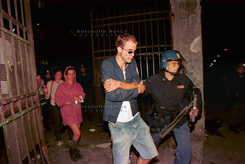 Big fight between demonstrators and Italian police during the protest against the G8 Summit in Genova on July 2001.Alcuni dei ragazzi che dormivano alla scuola Diaz vengono arrestati dopo l'irruzione della polizia.
