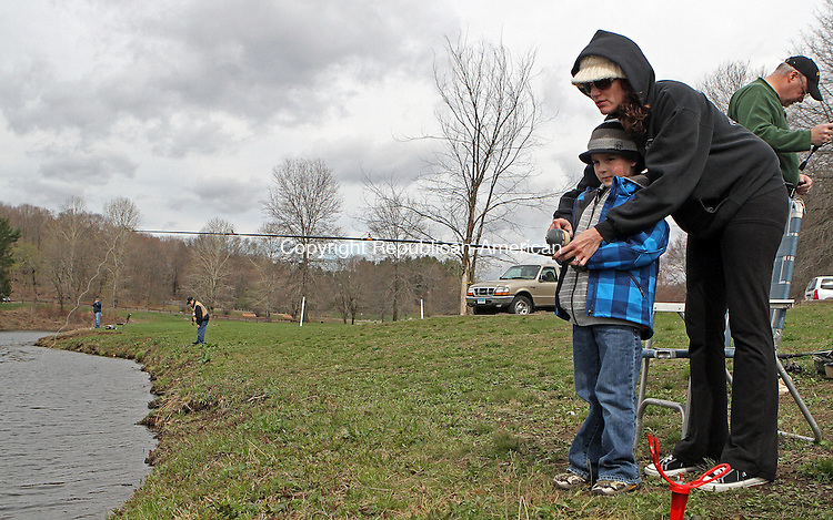 Middlebury, CT-042013MK20 Ayden Kane (5), from Naugatuck, gets some pointers from his mother, Jennifer Kane, during the opening day of fishing season in Connecticut at Hop Brook state park in Middlebury on Saturday morning.  Michael Kabelka / Republican-American