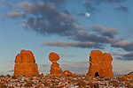 The full moon rises over Balanced Rock in Arches National Park near Moab, Utah.