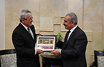 Palestinian Prime Minister Mohammad Ishtayeh, meets with Ambassador of Slovenia to Palestine Milko Dolencik, in the West bank city of Ramallah on June 16, 2019. Photo by Prime Minister Office