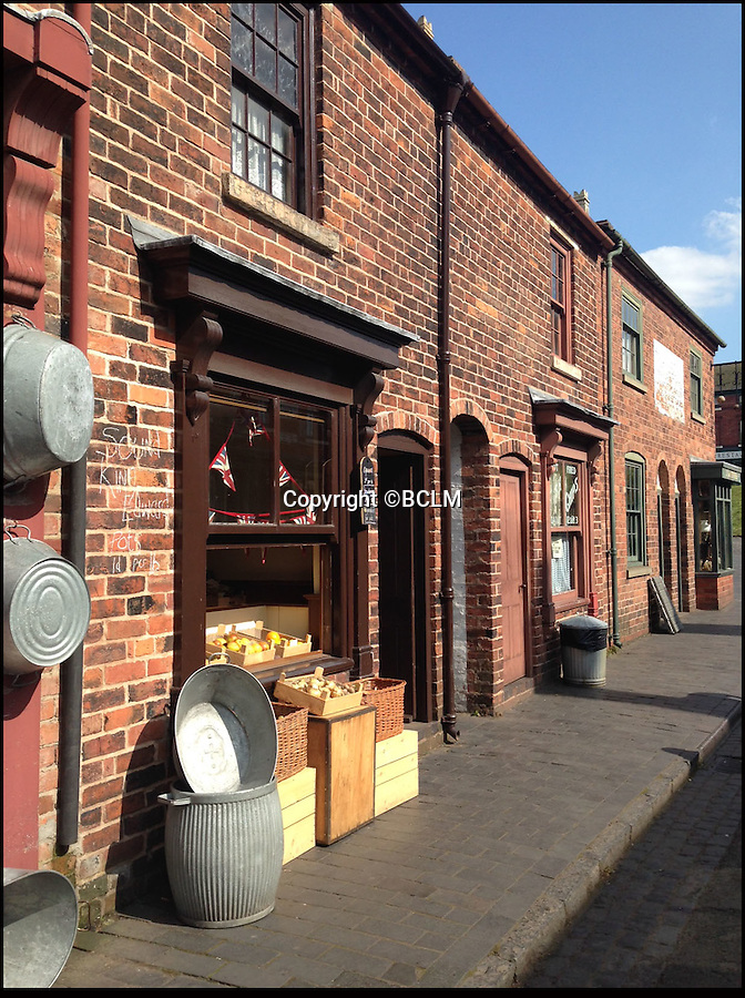 BNPS.co.uk (01202 558833)<br /> Pic: BCLM/BNPS<br /> <br /> Re-Open All Hours...<br /> <br /> A greengrocers shop in a Victorian two up two down has been reunited with the family that once owned it after it was painstakingly rebuilt at the Black Country Living Museum in Dudley.<br /> <br /> The turn-of-the-century greengrocers shop has re-opened for business almost a 100 years after it served its first customers - and it is an exact replica of how it used to be.<br /> <br /> Plucky housewife Gertrude Adey transformed her modest front room into a fruit and veg shop in 1916 to earn a few shillings so she could survive while husband William was off fighting in the First World War.<br /> <br /> In 1995 the historic building was demolished to pave the way for a new development in the town centre but 98 years after it first opened the shop is back in business after it was lovingly rebuilt brick by brick.<br /> <br /> The humble shop will only sell produce that was available at the time and any left over fruit and veg will be turned into pickles, chutneys and jams, just like it would have been back in the early 20th century.<br /> <br /> And staff will even be dressed in plain period clothing just as William and Gertrude would have worn. <br /> <br /> The opening of the time-warp shop is the culmination of a project by local historians who rebuilt the shop in the grounds of the Black Country Living open air museum.<br /> <br /> Three generations of the Adey family - William's grandson Jim, 85, great grandson Andrew, 54, and great-great granddaughter Melanie, 22 - officially opened the shop on Saturday.