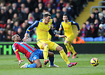 Crystal Palace's Jason Puncheon tussles with Arsenal's Mesut Ozil<br /> <br /> Barclays Premier League - Crystal Palace  vs Arsenal  - Selhurst Park - England - 21st February 2015 - Picture David Klein/Sportimage
