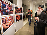 """Patriarch of the Serbian Orthodox Church His Holyness Irinej views the exhibition opening at the National Ethnographic Museum of the photo show """"Orthodoxy in America"""" with photos by Larry Angier of the iconography of Miloje Milinković ."""