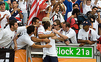 USA's Carlos Bocanegra (3) is hugged by USA fans after the match. Ghana defeated the USA 2-1 in their FIFA World Cup Group E match at Franken-Stadion, Nuremberg, Germany, June 22, 2006. Ghana advances to round of 16 and the USA is out of the tournament.
