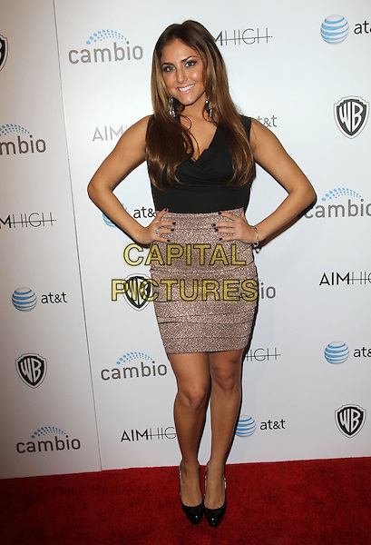 "Cassie Scerbo.""Aim High"" Los Angeles Premiere held at Trousdale, West Hollywood, California, USA..October 18th, 2011.full length beige gold skirt black top hands on hips .CAP/ADM/KB.©Kevan Brooks/AdMedia/Capital Pictures."