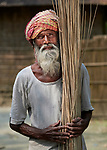 Samsul Haque dries jute in the sun in West Fasura, a village on an island in the Brahmaputra River in northern Bangladesh.