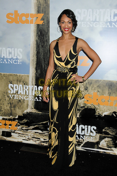 "Cynthia Addai-Robinson.""Spartacus: Vengeance"" Premiere Screening held at Arclight Cinemas, Hollywood, California, USA..January 18th, 2012.full length dress maxi black yellow print hand on hip.CAP/ADM/BP.©Byron Purvis/AdMedia/Capital Pictures."