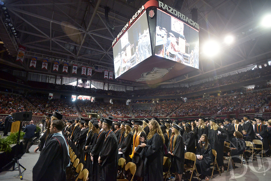 NWA Democrat-Gazette/BEN GOFF @NWABENGOFF<br /> Graduates stand for recognition Saturday, May 20, 2017, during commencement for the Bentonville High School class of 2017 in Bud Walton Arena in Fayetteville.