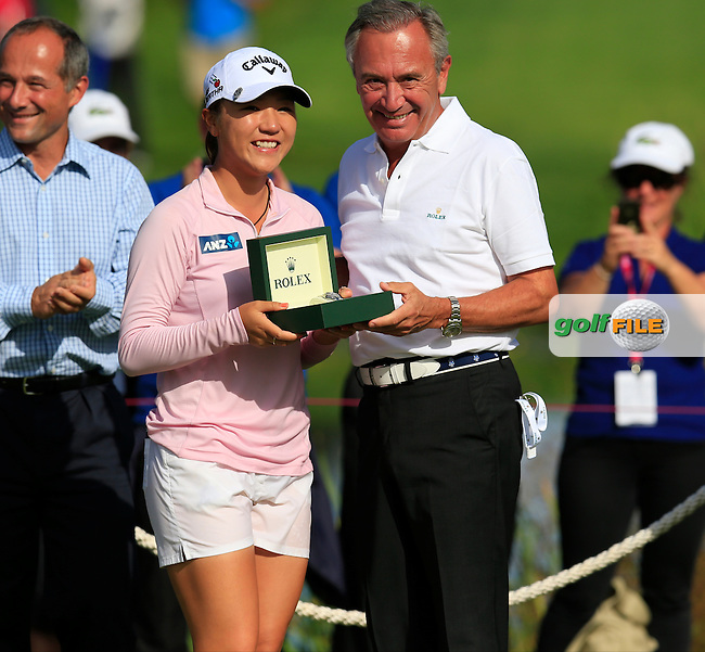 Lydia Ko (NZL) presented with a Rolex watch by Jean-Noel Bioul after winning the Championship by 6 shots and makes history by becoming the youngest Major winner in golf at the end of Sunday's Final Round of the LPGA 2015 Evian Championship, held at the Evian Resort Golf Club, Evian les Bains, France. 13th September 2015.<br />