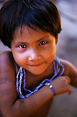 Koatinemo village, Brazil. Young Assurini Indian girl with blue bead necklace. Para State.