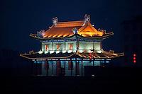 Evening landscape view of a Xī'ān chéngqiáng gate tower in the Xī'ān Shì Weiyang District in Shaanxi Province.  © LAN