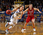 BROOKINGS, SD - JANUARY 25: Tylee Irwin #21 from South Dakota State University drives against Jaycee Bradley #12 from the University of South Dakota during their game Thursday night at Frost Arena in Brookings. (Photo by Dave Eggen/Inertia)