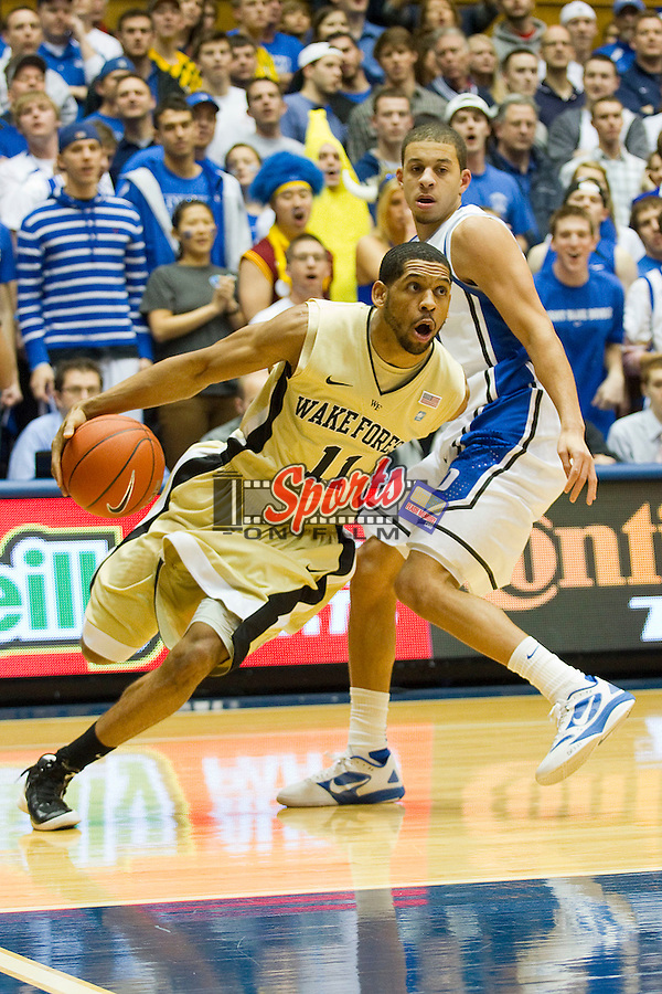 C.J. Harris #11 of the Wake Forest Demon Deacons drives the baseline past Seth Curry #30 of the Duke Blue Devils at Cameron Indoor Stadium on January 19, 2012 in Durham, North Carolina.  The Blue Devils defeated the Demon Deacons 91-73.  (Brian Westerholt / Sports On Film)