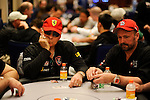 Frank Cieri and Dennis Phillips dressed alike and seated next to each other during play on Day 1.