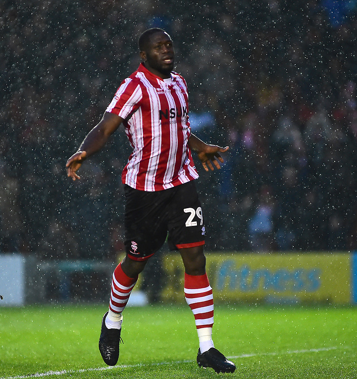 Lincoln City's John Akinde celebrates scoring his side's second goal<br /> <br /> Photographer Andrew Vaughan/CameraSport<br /> <br /> The EFL Sky Bet League Two - Saturday 15th December 2018 - Lincoln City v Morecambe - Sincil Bank - Lincoln<br /> <br /> World Copyright © 2018 CameraSport. All rights reserved. 43 Linden Ave. Countesthorpe. Leicester. England. LE8 5PG - Tel: +44 (0) 116 277 4147 - admin@camerasport.com - www.camerasport.com