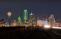 I like this because you got another view of the city at nigh as the car light left a trail on the bridge as they passed by. This cityscape has all the usual iconic dallas buildings like the Reuion Tower, Heritage Plaza, Fountain Place, Bank of America, to the alway colorful Omni Hotel in view.