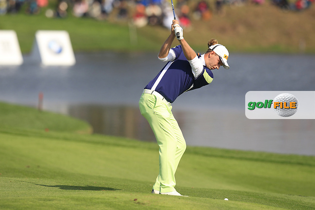 Marcel Siem (GER) plays his 2nd shot at the 9th hole during Sunday's Final Round of the 2014 BMW Masters held at Lake Malaren, Shanghai, China. 2nd November 2014.<br /> Picture: Eoin Clarke www.golffile.ie