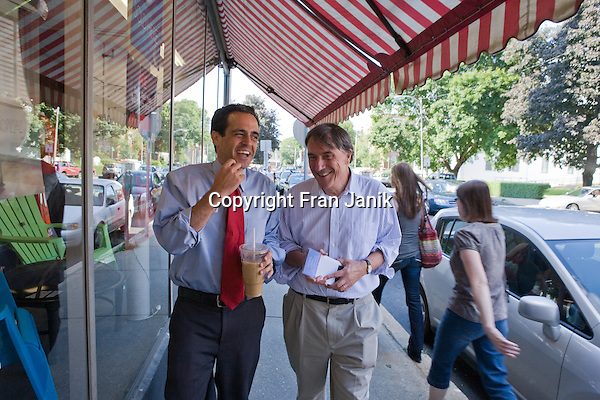 Matt Dunne,democratic candidate for governor in Vermont (left) and Peter Galbraith, democratic candidate for the Vermont senate share a light moment while campaigning in Brattleboro, Vermont